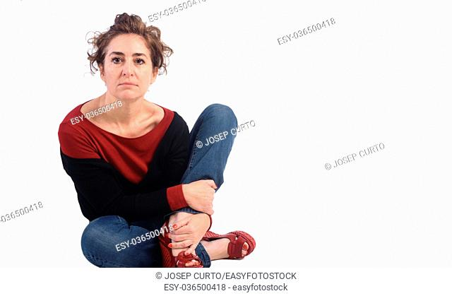 Woman crouching on a white background