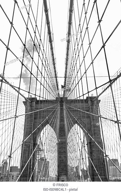 View of Brooklyn Bridge and American flag, B&W, New York, USA