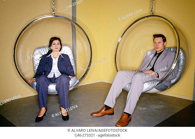 Executives sit in 'Bubble Chairs' (designed by Eero Aarnio, 1968)