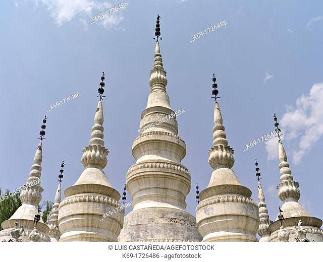 The 'mother-and-children pagodas' are an architectural complex rarely seen in China  The best-known example is the Manfeilong White Pagodas at Damenglong in...
