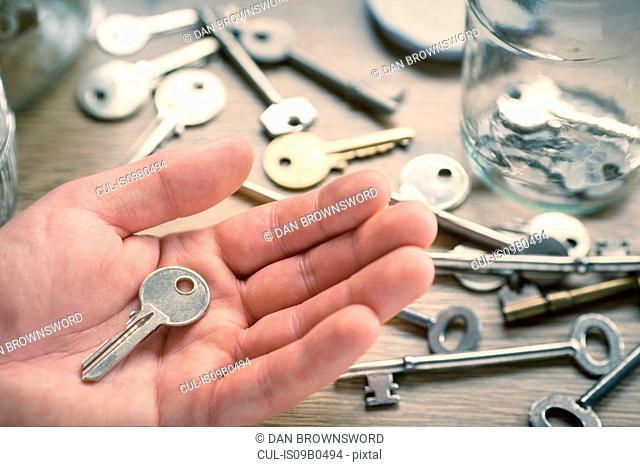 Man's hand holding key