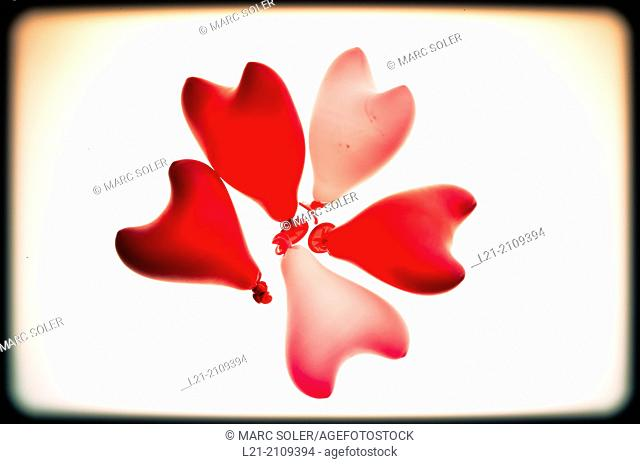 Group of five heart red shaped balloons