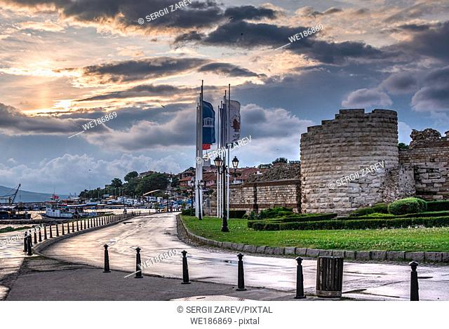 Nessebar, Bulgaria. The ruins of the fortress wall and tower of the old town of Nessebar in Bulgaria on a summer morning