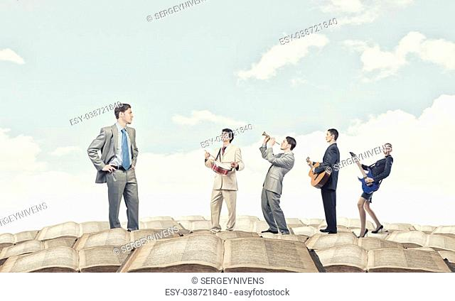 Businessman and colleagues playing different music instruments