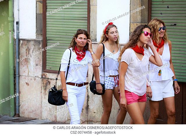 AMPUERO, SPAIN - SEPTEMBER 10: Unidentified group women just before the Bull Run on the street during festival in Ampuero, celebrated on September 10