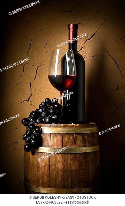 Wine on barrel in cellar with clay wall