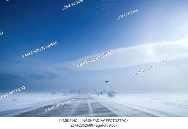 Arctic air and wind driven snow and ice create vivid sun dogs and haloing over western Iowa