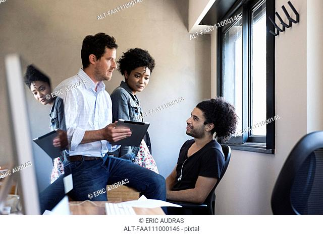 Colleagues working together in office