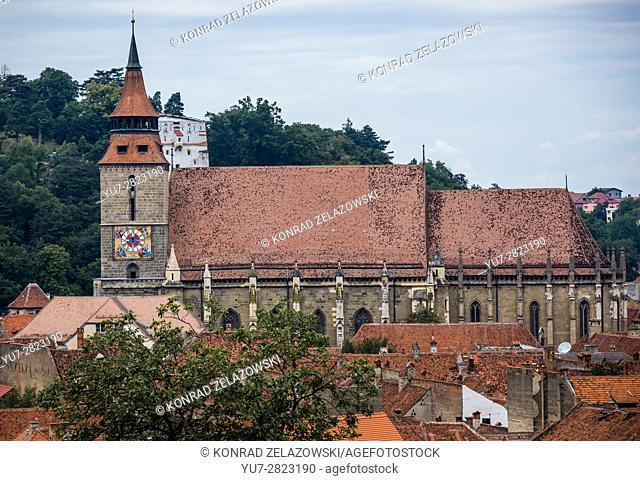 Black Church (Romanian - Biserica Neagra) in Brasov, Romania. White Tower on background