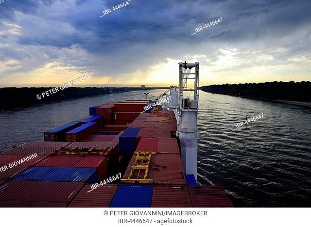 Cargo ship with containers, dusk, Elbe, Hamburg, Germany