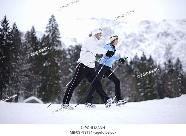 couple, Nordic Walking, on the side, snow   Athletes, 20-30 years, young, cap, gloves, sport, movement, activity, leisure time, health, recuperation, hobby, fit