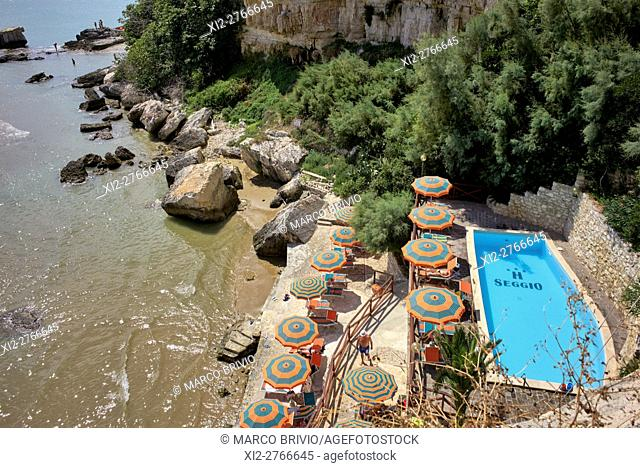 Sun bathing in Vieste. Vieste is a town, comune and former Catholic bishopric in the province of Foggia, in the Apulia region of southeast Italy