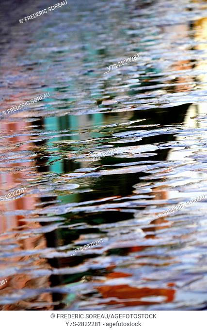 Rain puddle and water abstract reflection on a street of Trinidad, Cuba