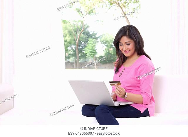 Woman with laptop shopping online