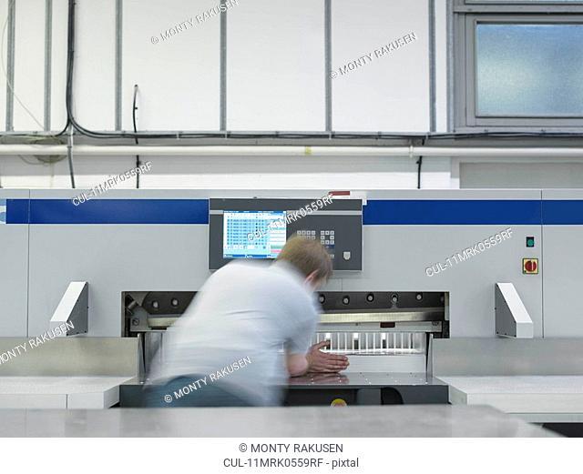 Worker Operating Printer