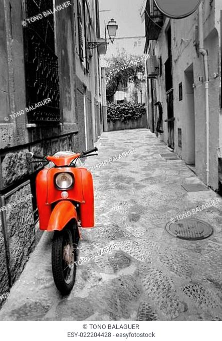 Mediterranean street with old retro red scooter in Mallorca