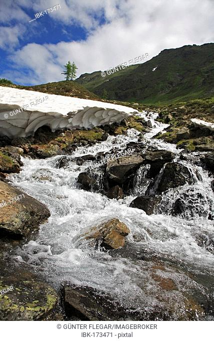 Snowmelt at the beginning of July direction Preberthoerl in the Alps, Murau, Styria, Austria