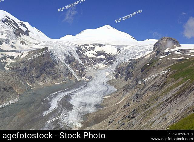Aerial view over shrinking Pasterze, longest glacier in Austria and Eastern Alps and the Johannisberg peak in 2018, Hohe Tauern NP, Carinthia, Austria