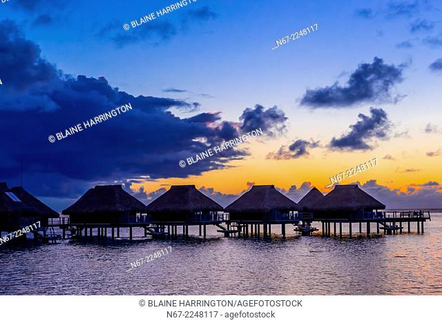 Overwater bungalows at sunset, Hilton Moorea Lagoon Resort, island of Moorea, French Polynesia
