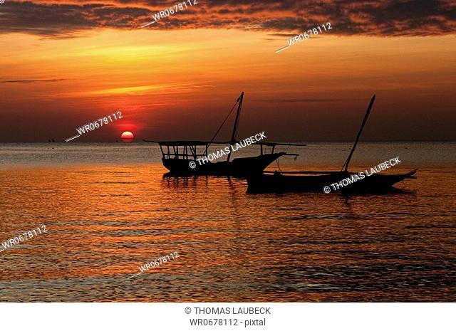 Fishing boats at sunset in the Indian Ocean, Nungwi Beach, Zanziabar, Tanzania, Africa