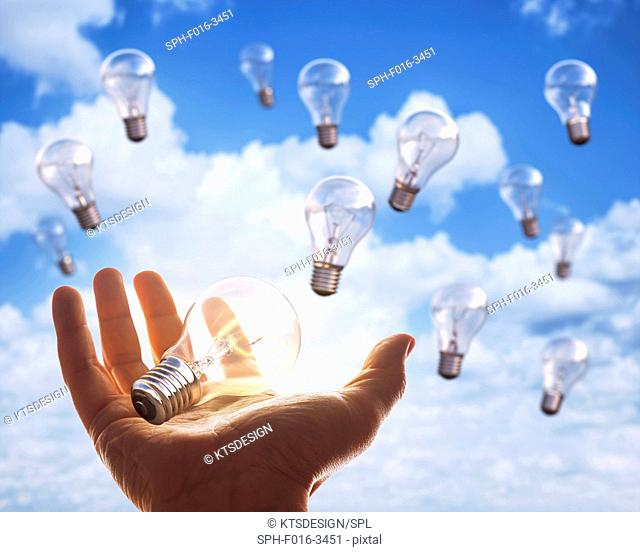 Open hand with light bulbs in sky