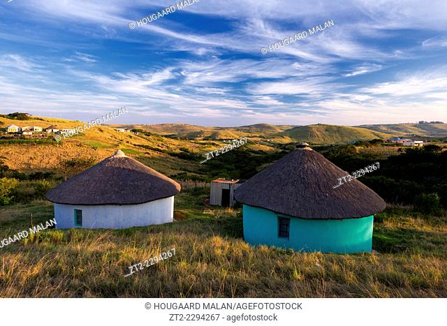 Landscape photo of traditional Xhosa houses in the hills of the Wild Coast. Wild Coast, Eastern Cape, South Africa