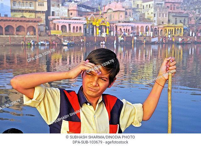 Indian boy in boat ; Vishram Ghat ; Mathura ; Uttar Pradesh ; India