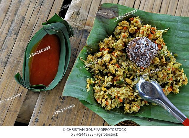 rice, vegetables and hot sauce served in banana leaves, village of Ban Pha Yong in mountain massif near Nong Khiaw, Luang Prabang Province, Laos, Southeast Asia