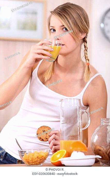 young woman having healthy breakfast