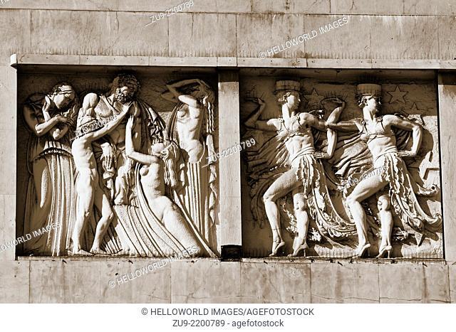 Stone carved frieze on facade of the art deco 1930's Eden building, a former theatre and cinema now a hotel, Praca dos Restauradores, Lisbon, Portugal