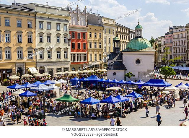 Tourists in Krakow, Old Market Square with the old St Wojciech Church, view from above on a beautiful Summer day, Krakow, Poland, Europe