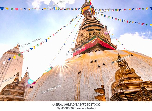 Swayambhunath Stupa, aka The Monkey Temple, during sunrise in Kathmandu, Nepal. A UNESCO Heritage Site. Ancient ruins and stone temples