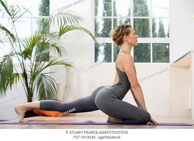 Healthy young woman doing yoga