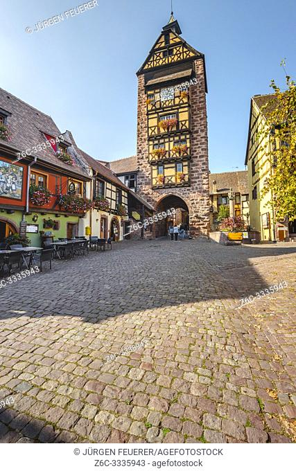 old town gate of the historical village Riquewihr, Alsace, France, town wall and tower
