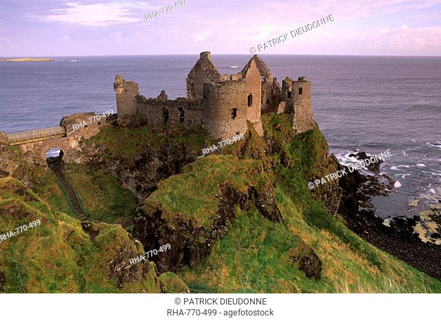 Dunluce castle, spectacular castle-crowned crag, Antrim coast, near Portrush, County Antrim, Ulster, Northern Ireland, United Kingdom, Europe