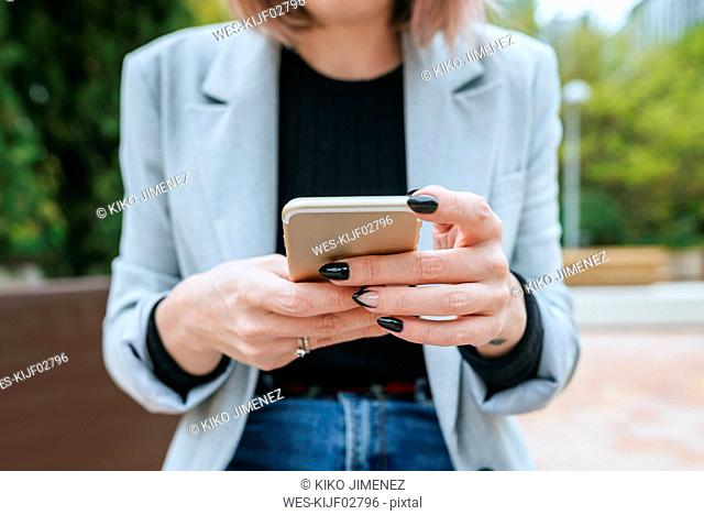 Close-up of woman using cell phone outdoors