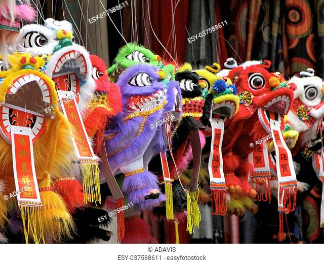 Chinese New Year's dragons hanging in market