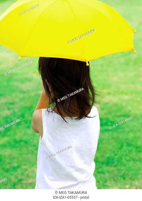 Rear view of a girl holding an umbrella