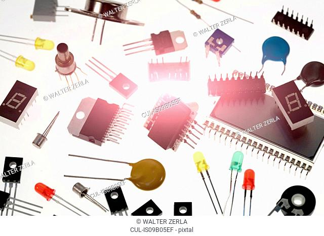 Variety of diode and transistors, white background