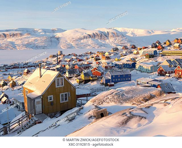 Town Uummannaq during winter in northern Greenland. Background is Nussuaq (Nugssuaq) peninsula. America, North America, Denmark, Greenland
