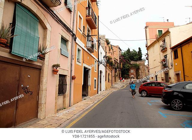 Tourists walking down a street in Tarragona, Spain, Europe