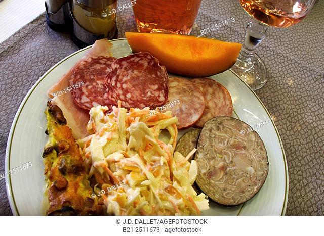 Starter: ham, sausages, andouillette, melon and salads, France