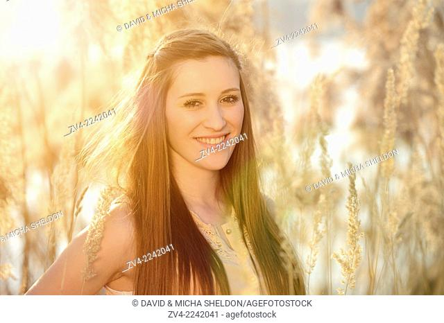 Portrait of a good looking young woman in the reeds on a sunny day in early spring