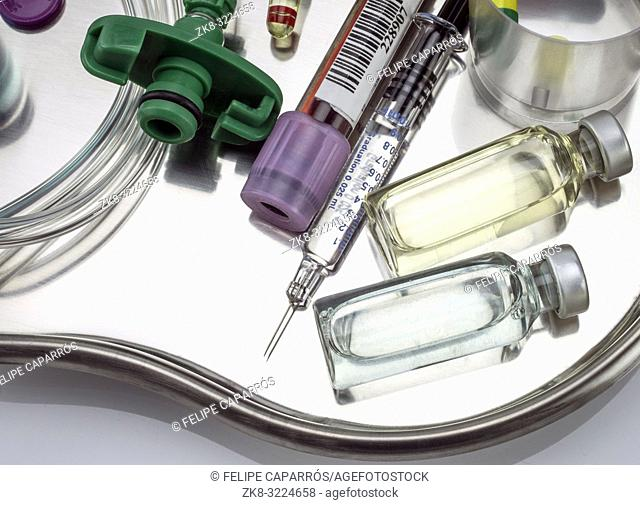 Several vials and medicines in a tray metal in a hospital, conceptual image