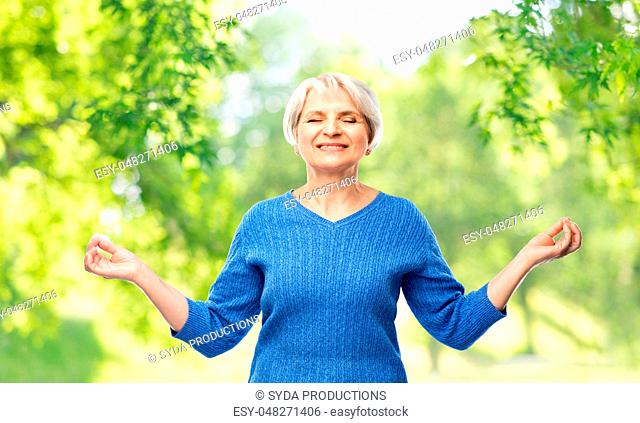 smiling senior woman in blue sweater chilling