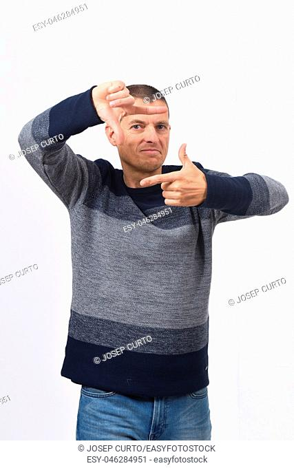 man making the gesture of frame