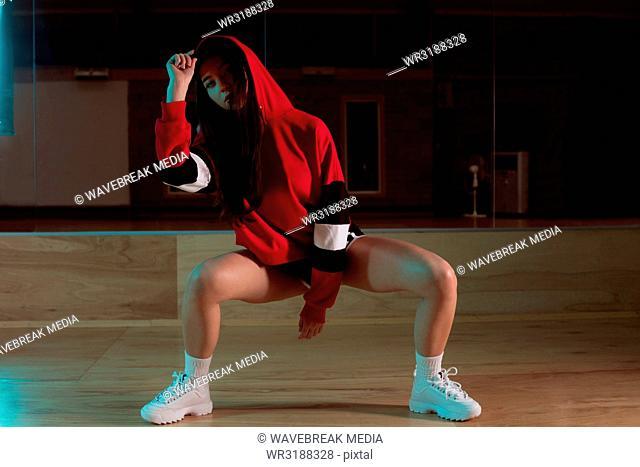 Female dancer dancing in dance studio
