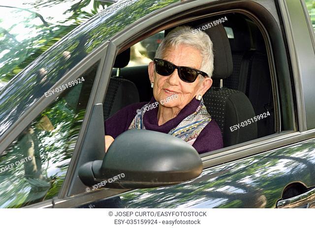 senior woman driving a car