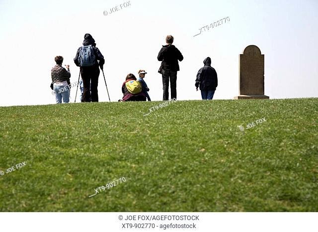 group of female tourists on the forradh royal seat area of the hill of tara teamhair na ri hill of the king archaeological complex in county meath republic of...