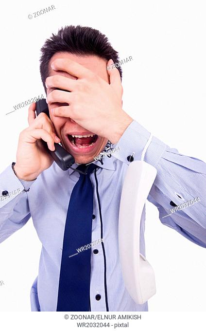 Crazy man with phone on white